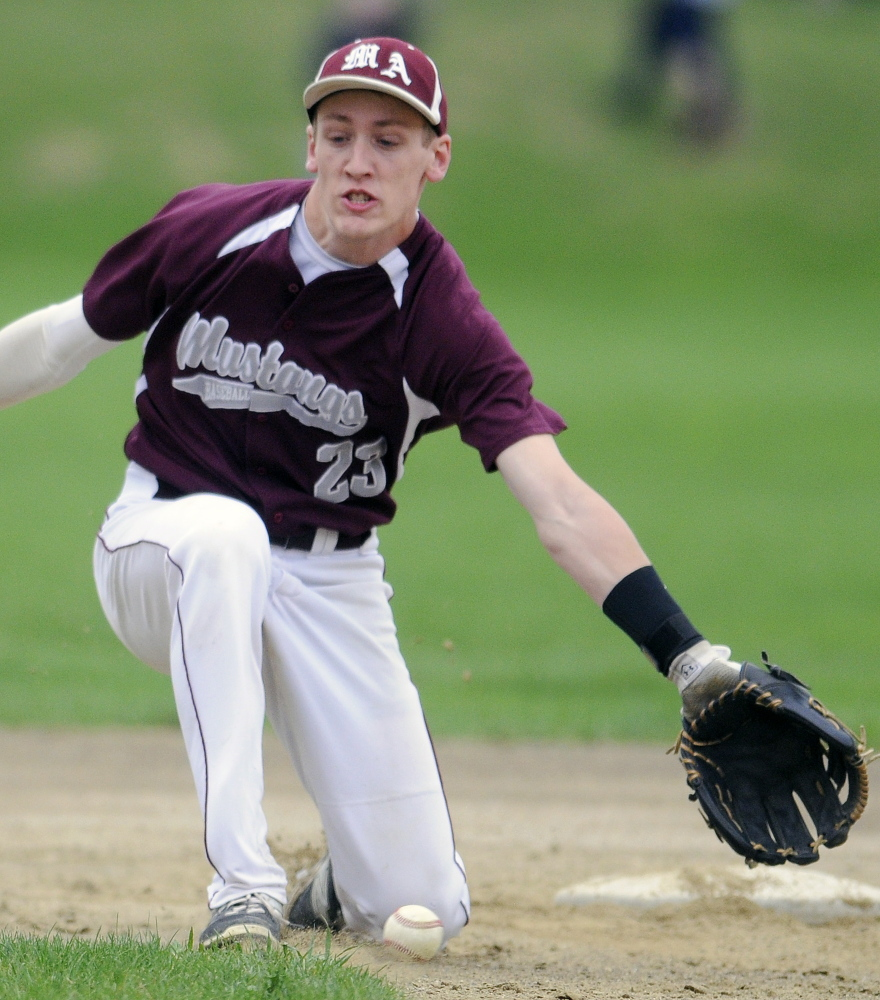 In this May 12, 2015 photo, Monmouth Academy's Hunter Richardson tried to collect a grounder during a Mountain Valley Conference game against St. Dominic Academy. Richardson and the Mustangs have opened this spring with three convincing wins in a row.