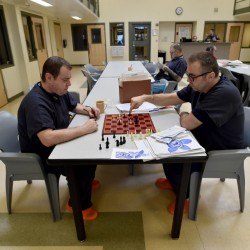 Inmates play a game of chess at the Somerset County Jail in East Madison on Friday. The jail, which boards inmates from other counties that have crowding problems, will benefit from a supplemental jail funding bill passed by the Legislature Friday, when it overrode a Gov. Paul LePage veto.