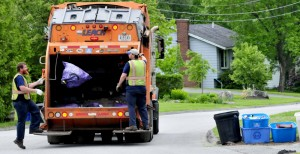 Waterville Public Works employees pick up trash last summer in Waterville. The city's solid waste committee has recommended that the city take its trash to the Crossroads landfill in Norridgewock after its contract with the Penobscot Energy Recovery Co. ends in 2018.