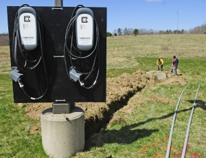 ReVison Energy workers install a pair of electric car chargers Thursday at the Maple Hill Farm Inn and Conference Center in Hallowell, the first inn in the area to provide the service.