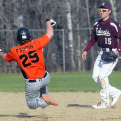 Gardiner runner Josh Farrin slides safely into second as Nokomis shortstop Josh Perry watches during a Kennebec Valley Athletic Conference Class B game in Gardiner.