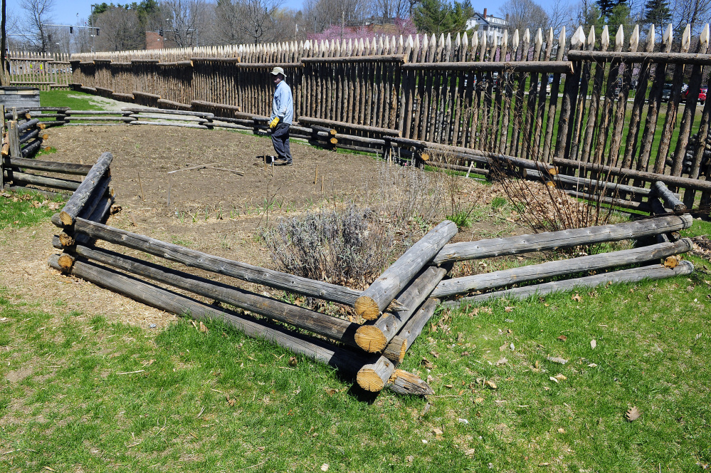 Pete Morrissey talks on Wednesday about what's planted in the garden, which is surrounded by a fence made from old palisade posts, at Old Fort Western in Augusta.