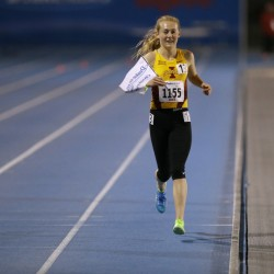 Iowa State redshirt sophomore Bethanie Brown takes a victory lap after winning the women's 5000-meter run at the Drake Relays on Thursday in Des Moines, Iowa.