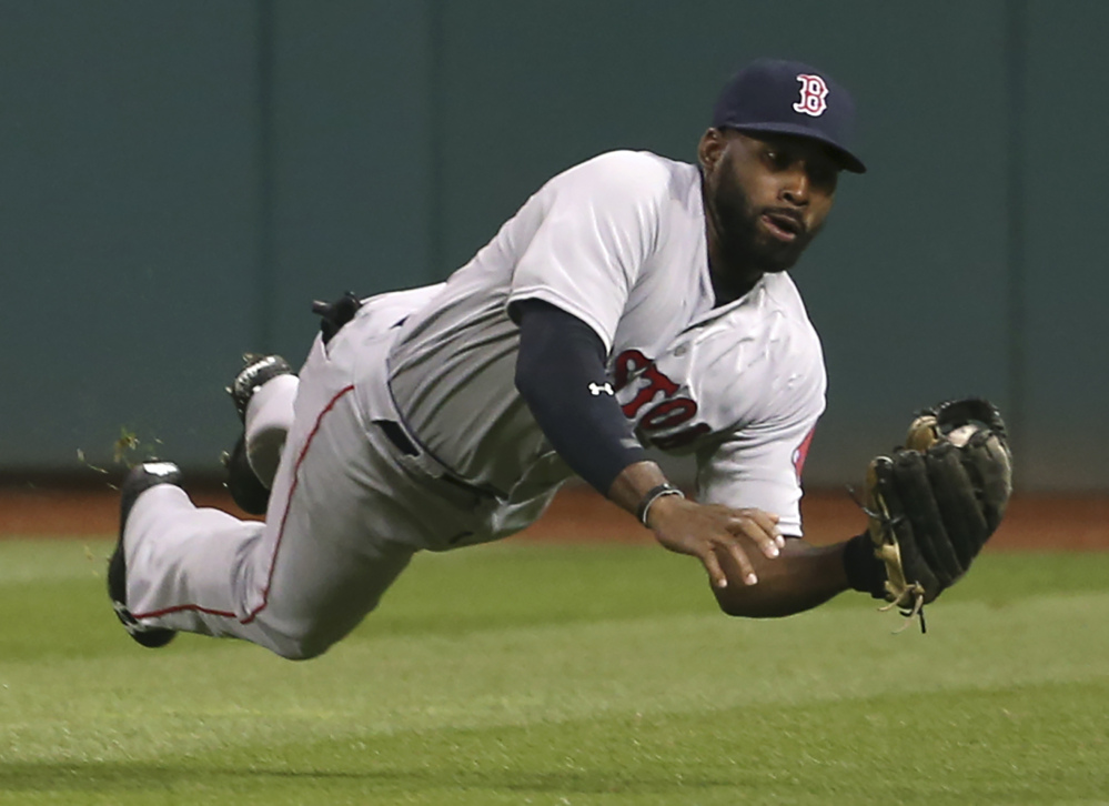 Boston's Jackie Bradley makes a diving catch of a ball hit by Cleveland's Yan Gomes in the seventh inning Wednesday night in Cleveland.