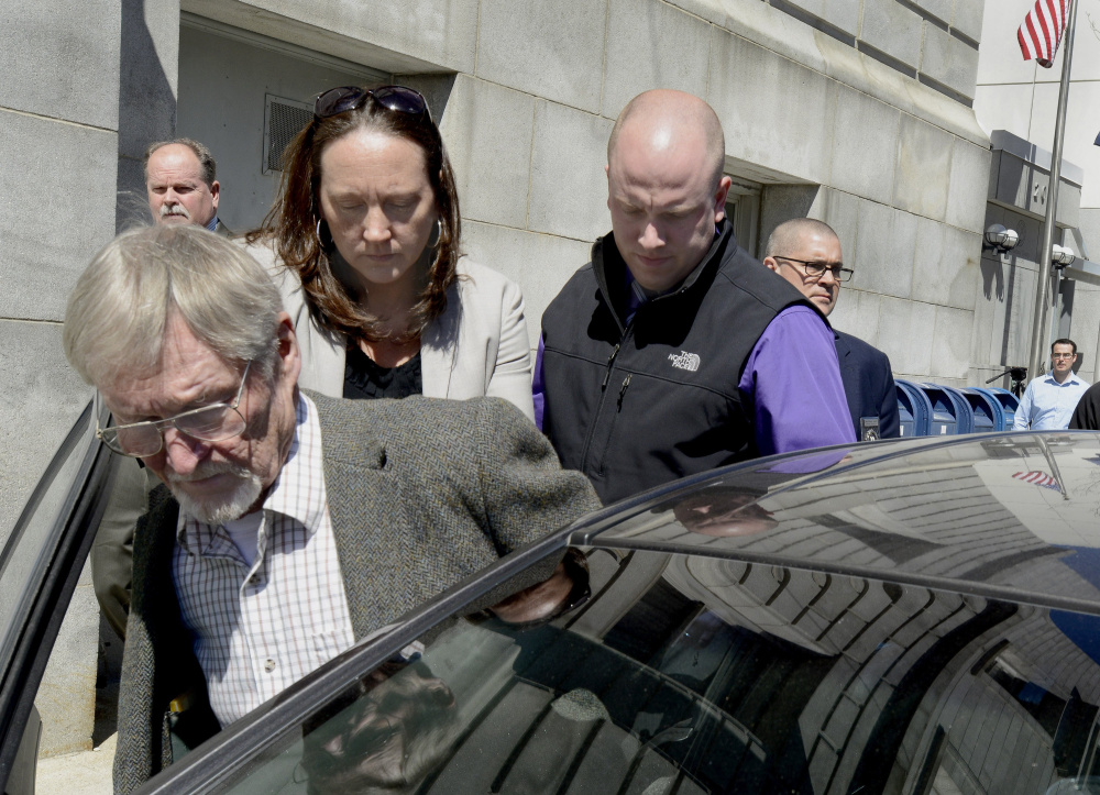 """Merrill """"Mike"""" Kimball is led out of the Cumberland County Courthouse after being found guilty of murder last year. He is appealing the verdict."""
