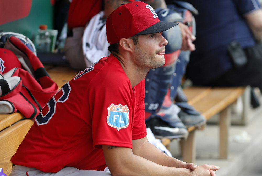 Boston Red Sox's Joe Kelly sits in the dugout in the third inning of a spring training baseball game against the Minnesota Twins on Tuesday, March 29, 2016, in Fort Myers, Fla. (AP Photo/Tony Gutierrez)