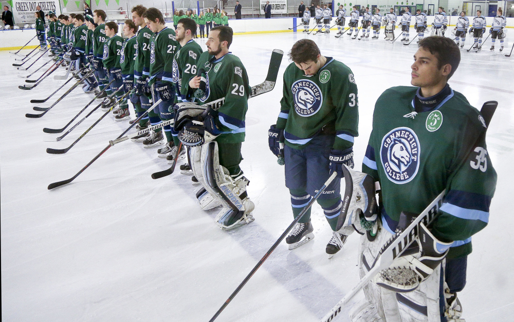 Members of the Connecticut College men's hockey team wear patches to mark the Green Dot hockey game in February in New London, Conn. The U.S. Air Force visited the college in March to get a look at a school that has been using the Green Dot program to stem sexual assault. The Air Force is introducing the program at all its installations.
