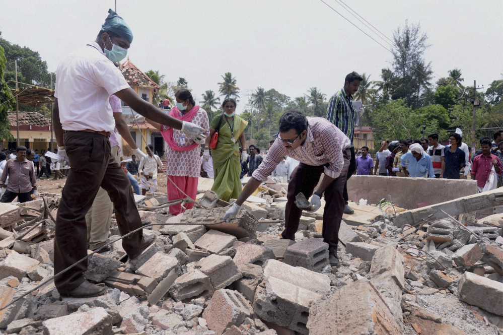 A building collapsed after a massive fire broke out during a fireworks display at the Puttingal temple complex in Paravoor village, north of Thiruvananthapuram, southern Kerala state, India, on Sunday.