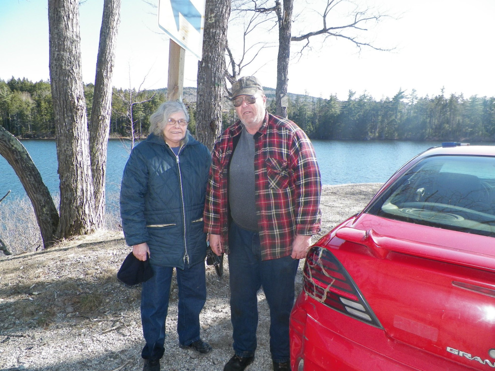 Leonard and Rosemary Wallace came to the aid of a mother and her two children after the car the family was riding in landed in Fox Pond. Maine State Police photo