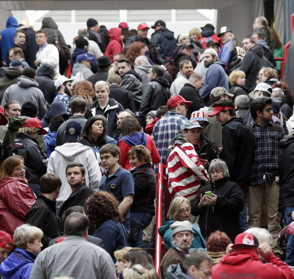 Supporters of Republican presidential candidate Donald Trump wait to get into the Times Union Center for a rally in Albany, N.Y., this month. He has the reputation to some of being a philanthropist, but charity records show he has donated little of his own money recently.