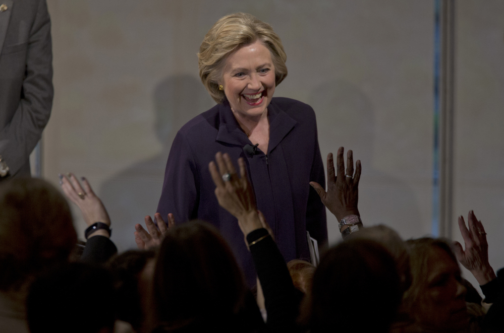 Democratic presidential candidate Hillary Clinton greets members of the audience during a Glassdoor Pay Equality Roundtable on Tuesday in New York.