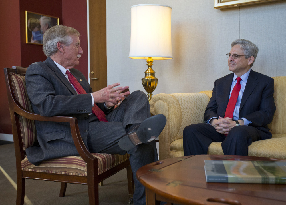 Judge Merrick Garland, right, President Barack Obama's choice to replace the late Justice Antonin Scalia on the Supreme Court, meets with Sen. Angus King, I-Maine, on Capitol Hill in Washington on Wednesday.
