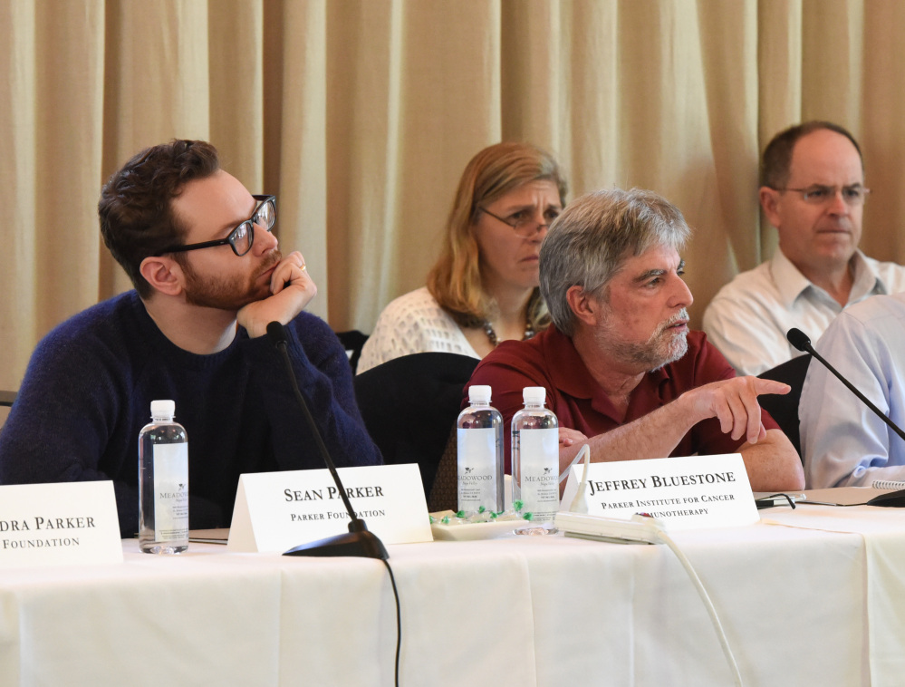 From left, Sean Parker and Jeffery Bluestone at the Parker Institute for Cancer Immunotherapy Scientific Retreat in St. Helena, Calif., describe their project to speed development of cancer-fighting drugs that harness the immune system.