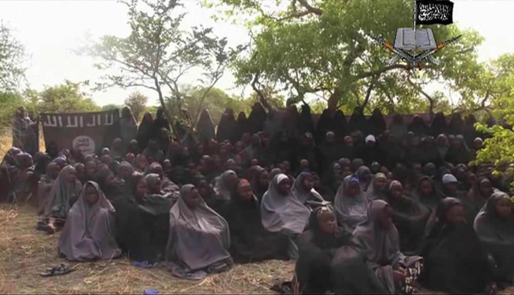 This image taken from a May 12, 2014 video by Nigeria's Boko Haram terrorist network, shows the alleged missing girls abducted from the northeastern town of Chibok. A schoolmate says she cried with joy when she saw a Boko Haram video appearing to show some of Nigeria's kidnapped Chibok girls.