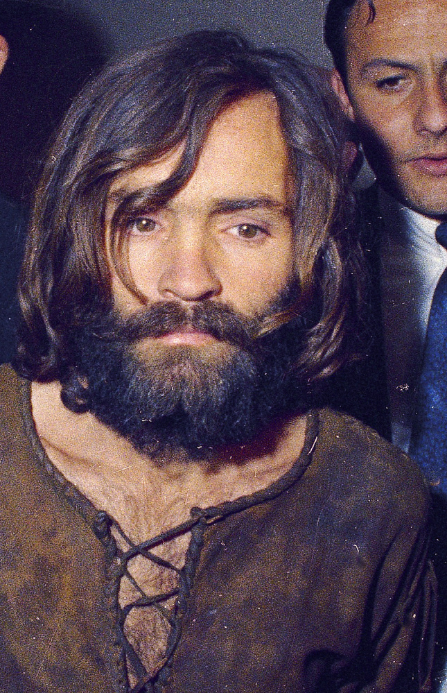 Charles Manson is escorted to his arraignment on conspiracy-murder charges in connection with the Sharon Tate murder case in 1969 in Los Angeles, Calif.