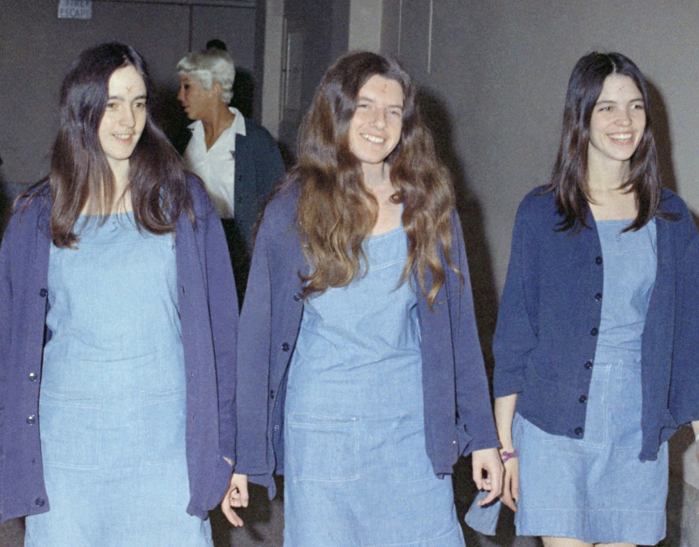 Charles Manson followers, from left, Susan Atkins, Patricia Krenwinkel and Leslie Van Houten walk to court to appear for their roles in the 1969 cult killings of seven people, including pregnant actress Sharon Tate, in Los Angeles, Calif., in August 1970.
