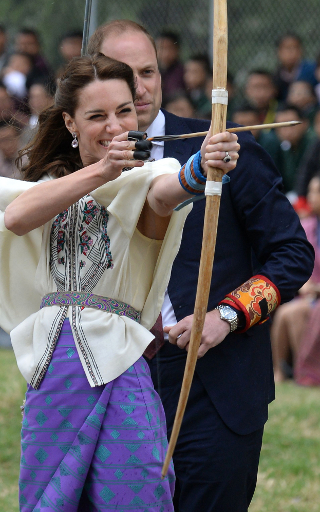 Kate, Duchess of Cambridge, takes part in an archery event as her husband, Prince William, looks on in Thimphu, Bhutan on Thursday.