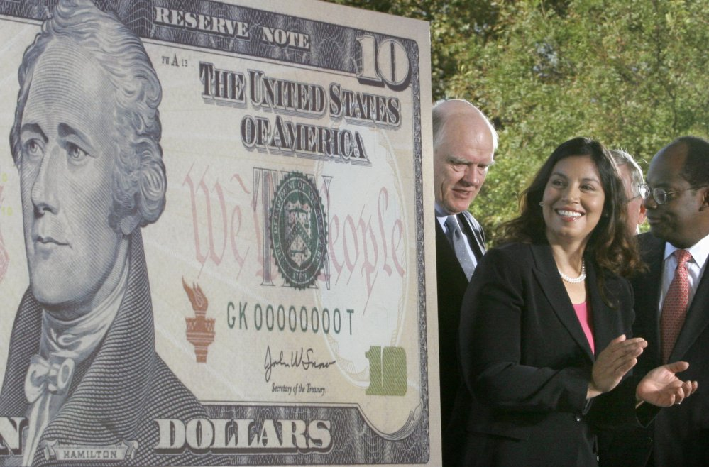 "Treasury officials unveil the $10 bill featuring the face of Alexander Hamilton in 2005. The hit musical ""Hamilton"" has sparked renewed interest in keeping him on the bill."
