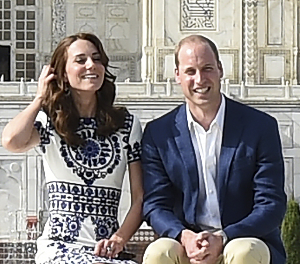 Britain's Prince William, and his wife, Kate, the Duchess of Cambridge, pose in front of the Taj Mahal in Agra, India, on Saturday. Agra is the last stop on the royal couple's weeklong visit.