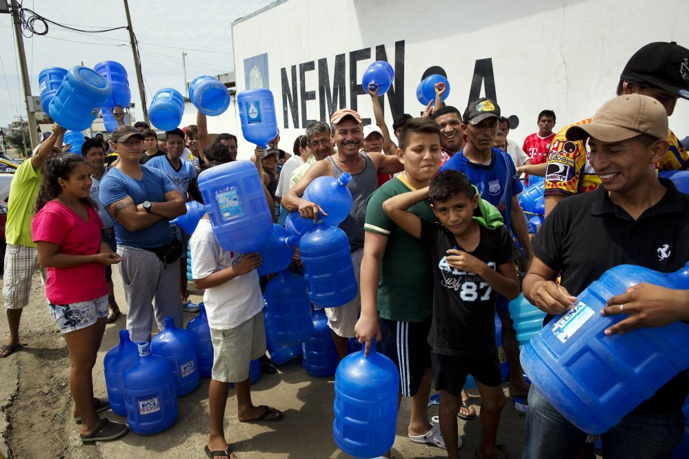 Survivors stand in line to buy potable water Monday in Manta, Ecuador. Saturday's 7.8-magnitude quake was the worst to hit the nation since one in 1949 that killed 5,000.