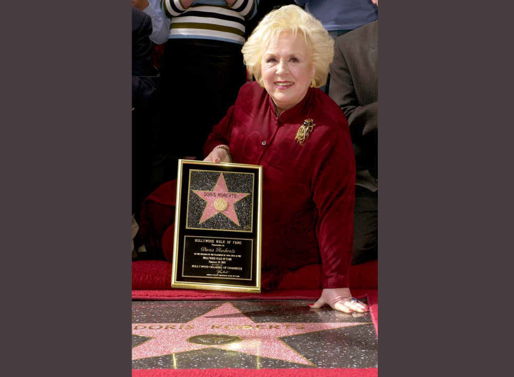 2003 Associated Press File Photo Actress Doris Roberts poses by her star on the Hollywood Walk of Fame during a ceremony in Los Angeles. Family spokeswoman said that the