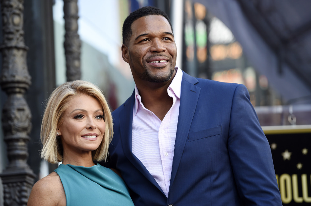"Kelly Ripa, left, poses with Michael Strahan, her co-host on the daily television talk show ""LIVE! with Kelly and Michael."" Ripa was absent from her daytime talk show Wednesday, the day after it was announced Strahan was leaving the show to join ""Good Morning America"" full time."