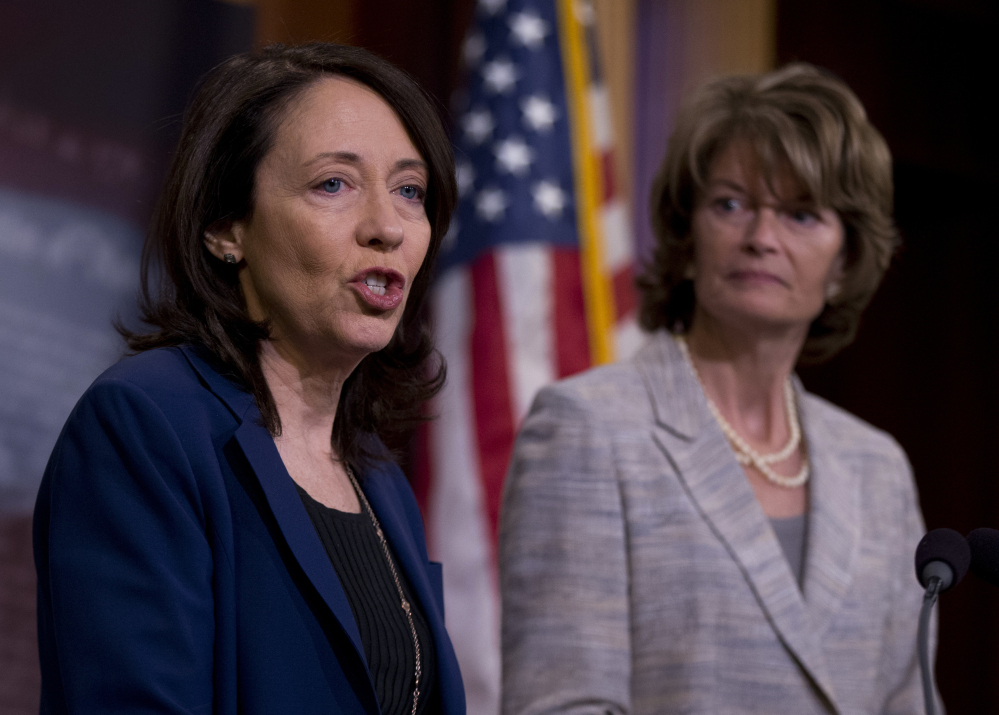 Sen. Maria Cantwell, D-Wash., and Sen. Lisa Murkowski, R-Alaska, discuss the new energy bill  Wednesday.