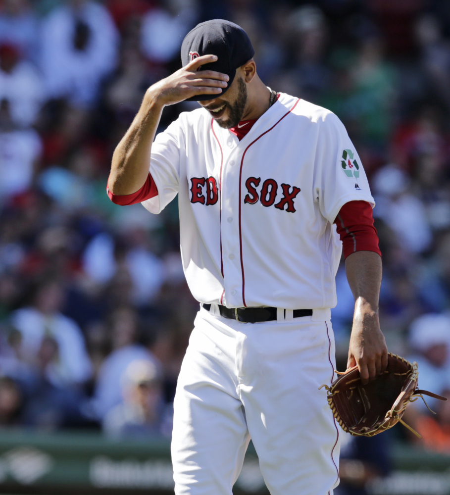 Boston Red Sox starting pitcher David Price tugs down on the brim of his cap while walking to the dugout after being pulled during the fourth inning of an MLB baseball game against the Tampa Bay Rays in Boston, Thursday, April 21, 2016. Price gave up six runs in the fourth. (AP Photo/Charles Krupa)
