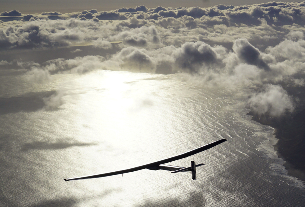 The solar-powered plane Solar Impulse 2, piloted by Bertrand Piccard, is seen in the air after taking off from Hawaii.