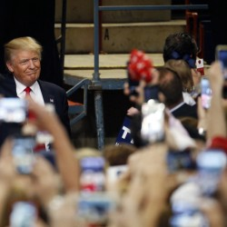 Republican presidential candidate Donald Trump arrives at a rally Thursday at the Pennsylvania Farm Show Complex and Expo Center in Harrisburg, Pa.