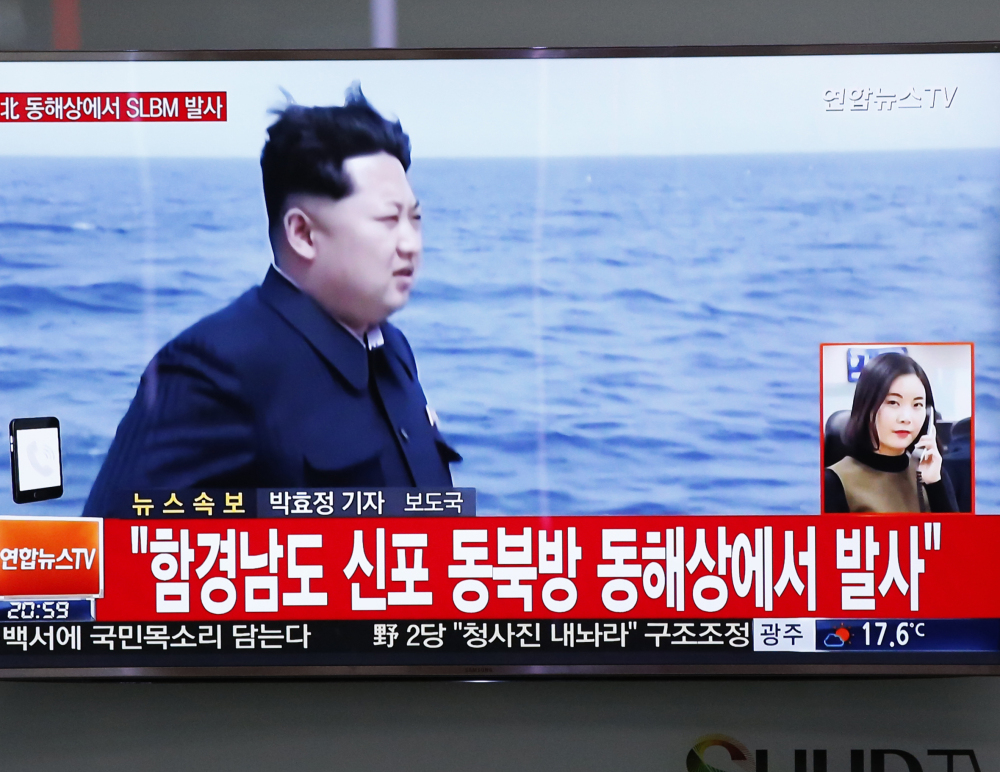 """South Korean file footage broadcast Saturday shows North Korea leader Kim Jong Un and words that translate to: """"North Korea fires submarine-launched ballistic missile or SLBM."""""""