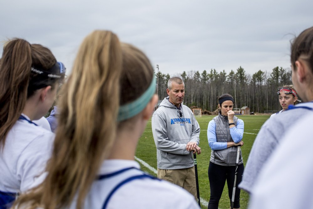 Kennebunk athletic director Joe Schwartzman, center left, runs the junior varsity girls' lacrosse team during Friday's practice, with help from assistant coach Lauren MacPherson, center right. As the number of athletic programs has risen dramatically, Schwartzman exemplifies the difficulties school officials face trying to find applicants for coaching positions.