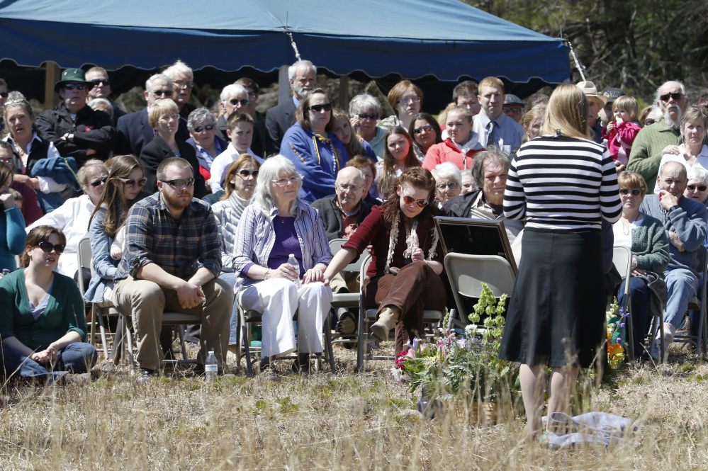 "Elizabeth Perron, right, wife of crash victim Adam Perron, addresses the crowd Sunday at a memorial service for her husband at the Holt Pond Preserve in Naples. ""Learning was his passion to a point he wasn't able to control. He was my own personal encyclopedia,"" she said.