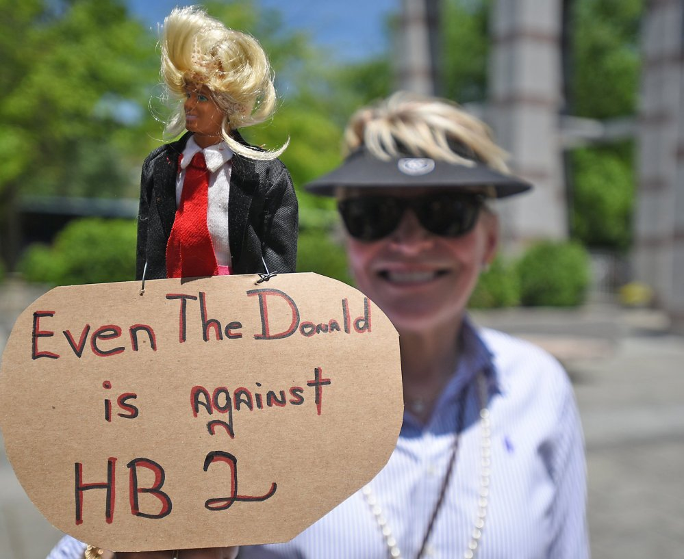 Nancy Hight shows off her Donald Trump doll Monday in Raleigh, N.C. House Bill 2 blocks local and state protections for lesbian, gay, bisexual and transgender people.