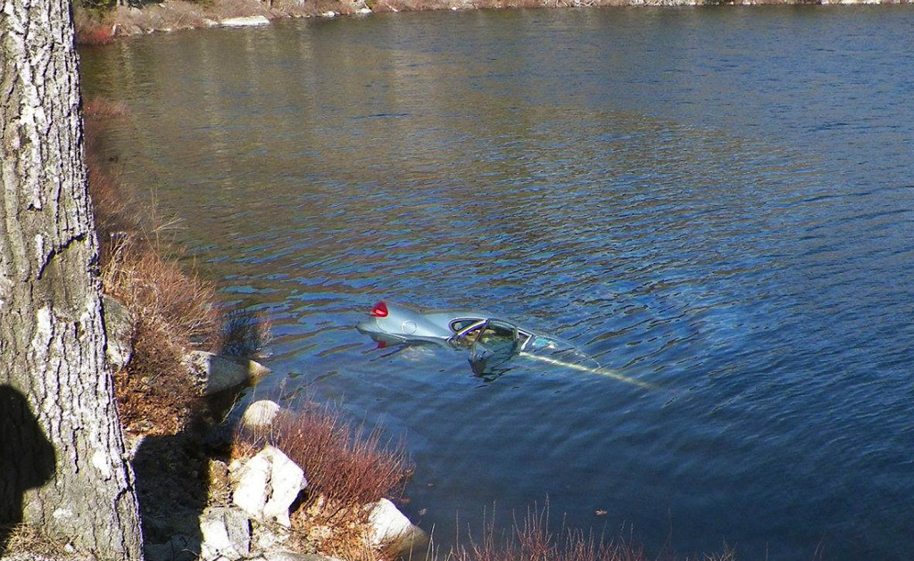 A car sinks in Fox Pond in Hancock County on Saturday. Maine State Police photo