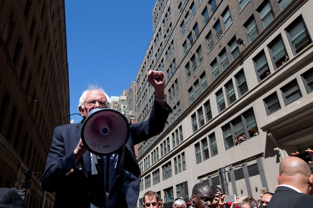 Bernie Sanders speaks to Communication Workers of America on a picket line Monday in midtown Manhattan. His recent string of primary wins has tested front-runner Hillary Clinton. The Associated Press