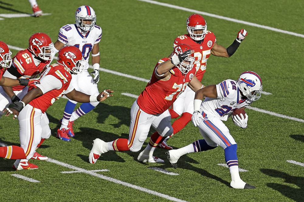 Kansas City Chiefs defensive end Mike DeVito (70) tackles Buffalo Bills running back Fred Jackson after a short gain during a Nov. 3, 2013, game in Orchard Park, N.Y. The Chiefs won 23-13. The Associated Press