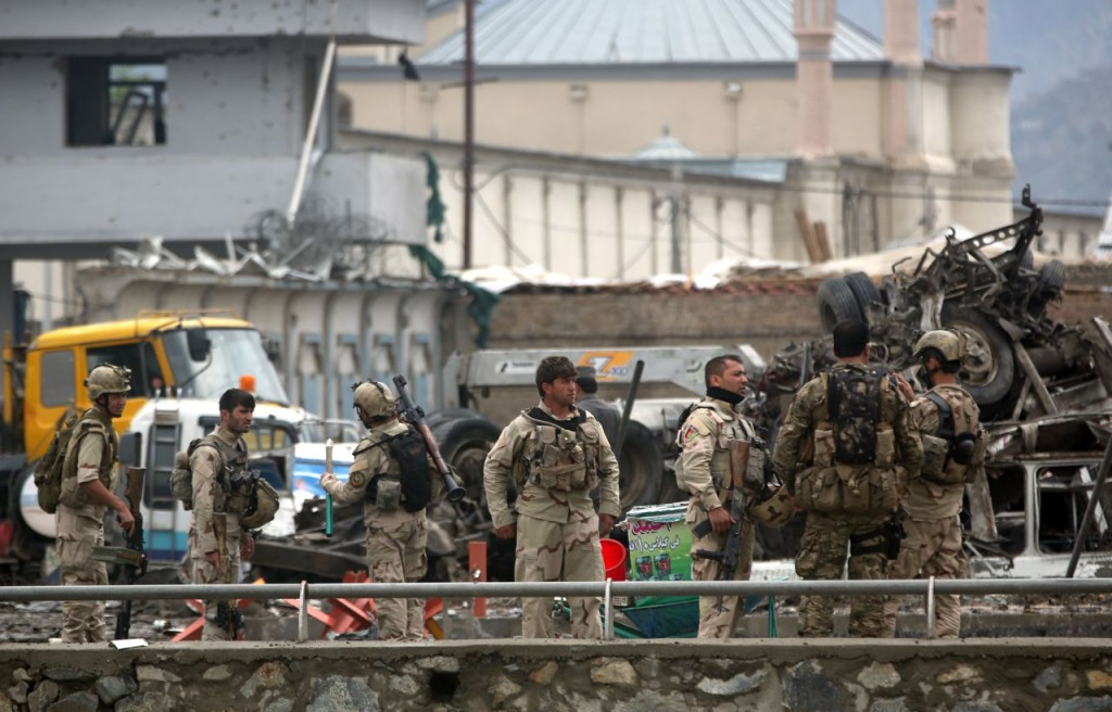 Afghan security forces inspect the site of a coordinated attack by the Taliban on a key government security agency in the capital Tuesday morning. The Associated Press