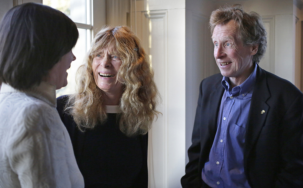 """Roberta """"Bobbi"""" Gibb, center, the first woman to run the entire course in the Boston Marathon, and Bill Rodgers, right, four-time winner of the race, speak with state Rep. Carolyn Dykema, D-Holliston, in Hopkinton, Mass., in this April 13, 2016, photo. The Associated Press"""
