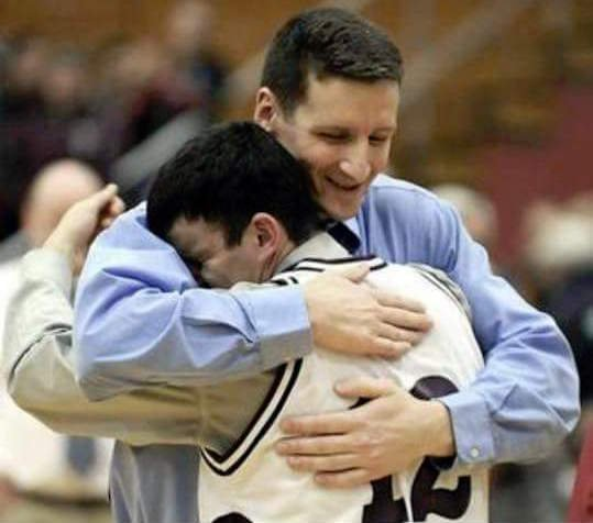 Coach Mike Adams and Josh Titus embrace after Edward Little High School's victory in its 2009 Eastern Maine championship game. Photo courtesy Mike Adams