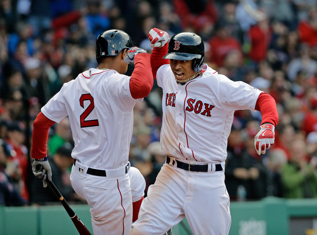 Mookie Betts celebrates his solo homer in the ninth inning against the Baltimore Orioles on Patriots Day. The Red Sox overtook the Orioles for first place in the American League East this weekend.