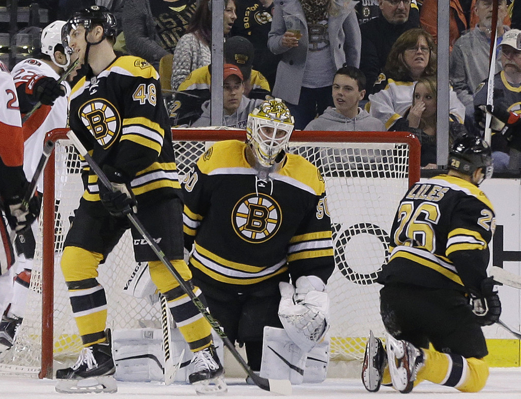Boston Bruins goalie Jonas Gustavsson (50) reacts along with teammates defensemen Colin Miller (48) and John-Michael Liles (26) after the Ottawa Senators scored in the second period of an NHL hockey game, Saturday in Boston. The Associated Press