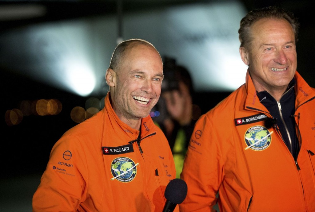 Solar Impulse 2 pilots Bertrand Piccard, left, and Andre Borschberg celebrate after Piccard landed their solar-powered plane at Moffett Field in Mountain View, Calif.,  on Saturday. The Associated Press