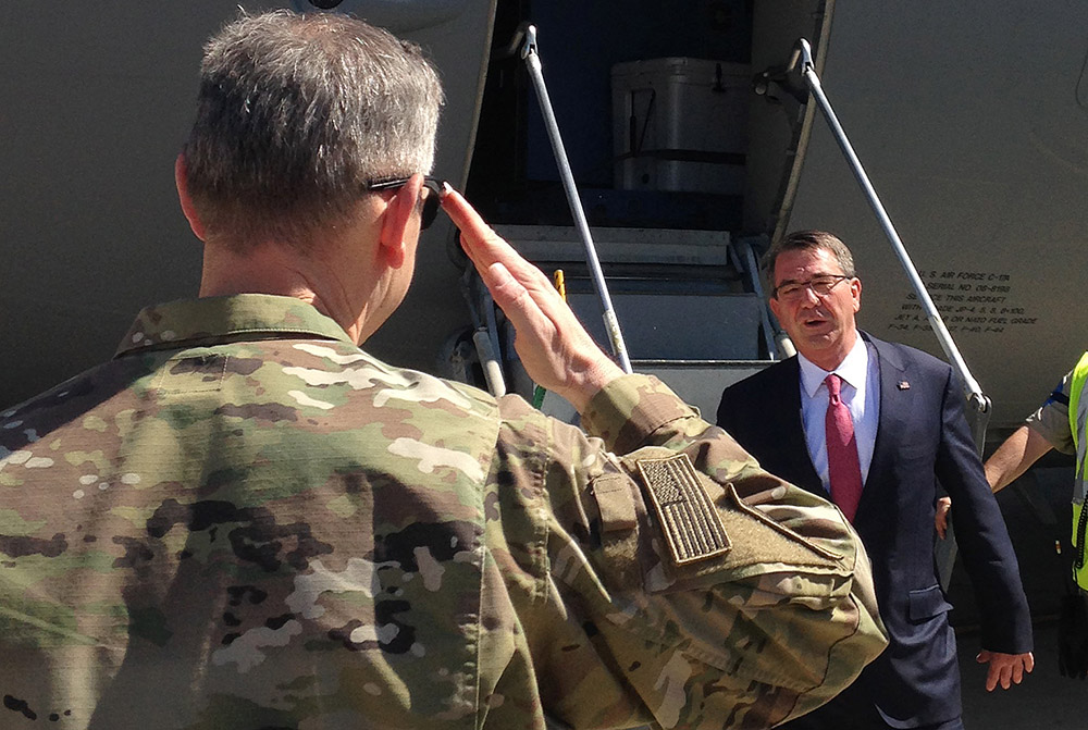 Defense Secretary Ash Carter is greeted by Lt. Gen. Sean MacFarland, top U.S. commander for the fight against the Islamic State, as he arrives Monday in Baghdad. The Associated Press
