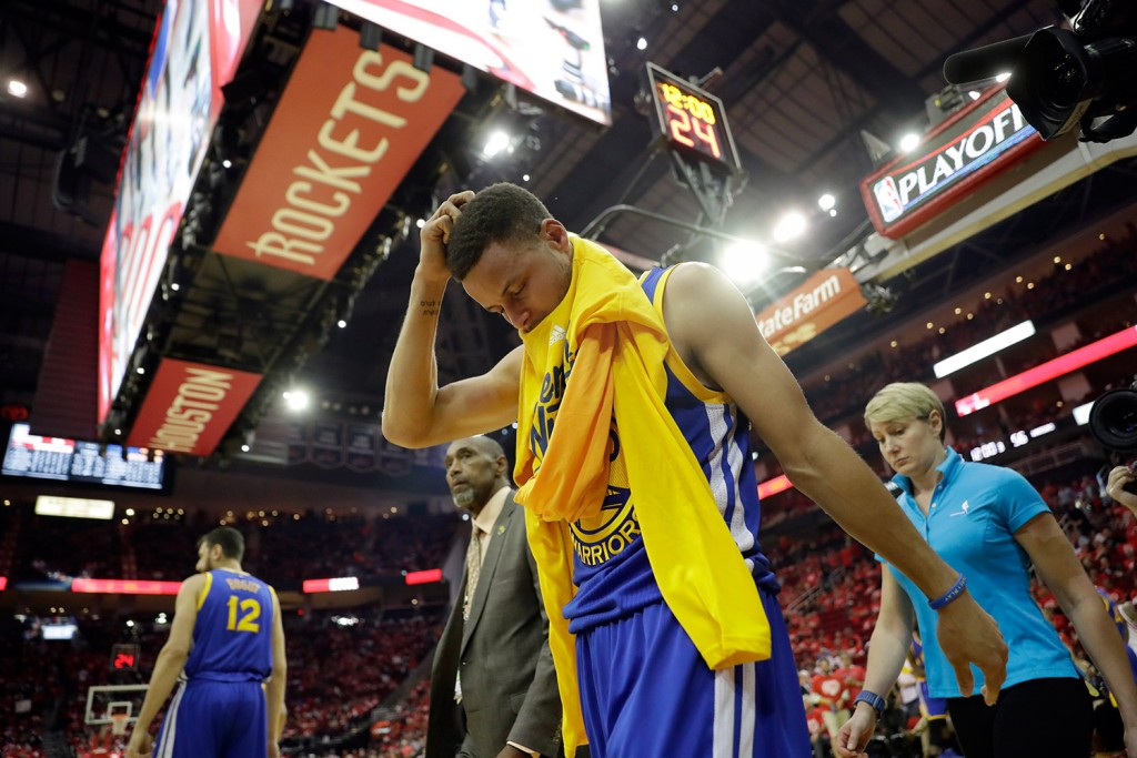 Golden State Warriors' Stephen Curry heads off the court and to the locker room at the start of the second half in Game 4 of a first-round NBA basketball playoff series against the Houston Rockets Sunday. Curry was injured at the end of the first half.