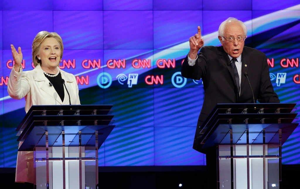 Hillary Clinton and Bernie Sanders try to speak over one another during Thursday's night's Democratic debate./Associated Press photo