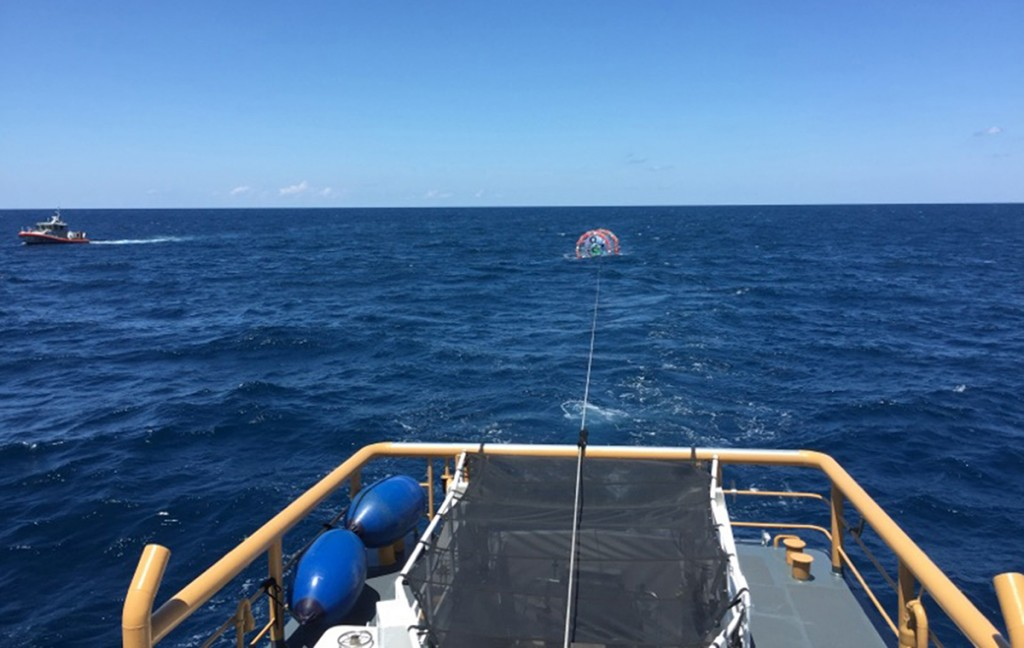 """The Coast Guard Cutter Gannet tows Reza Baluchi's  """"hydro pod"""" off the coast of Jupiter, Fla. The adventure runner was rescued for the second time on Sunday. Photo courtesy U.S. Coast Guard"""