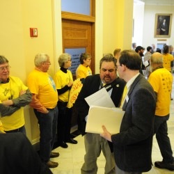 Advocates of a bill that aims to increase solar energy generation in Maine gather at the State House in Augusta Friday morning as lawmakers consider overriding Gov. Paul LePage's veto of that and dozens more bills. (Staff photo by Joe Phelan)