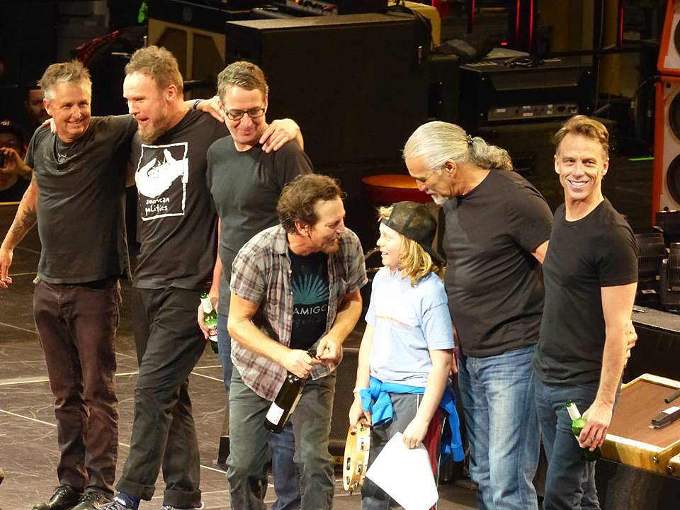 """Noah Keeley of Bar Harbor chats with Eddie Vedder and other members of Pearl Jam during a show in Quebec City. The band invited Noah onstage to play the song """"Sad"""" with them. The Keeley family has since been inundated with photos and video clips of the performance from other fans."""