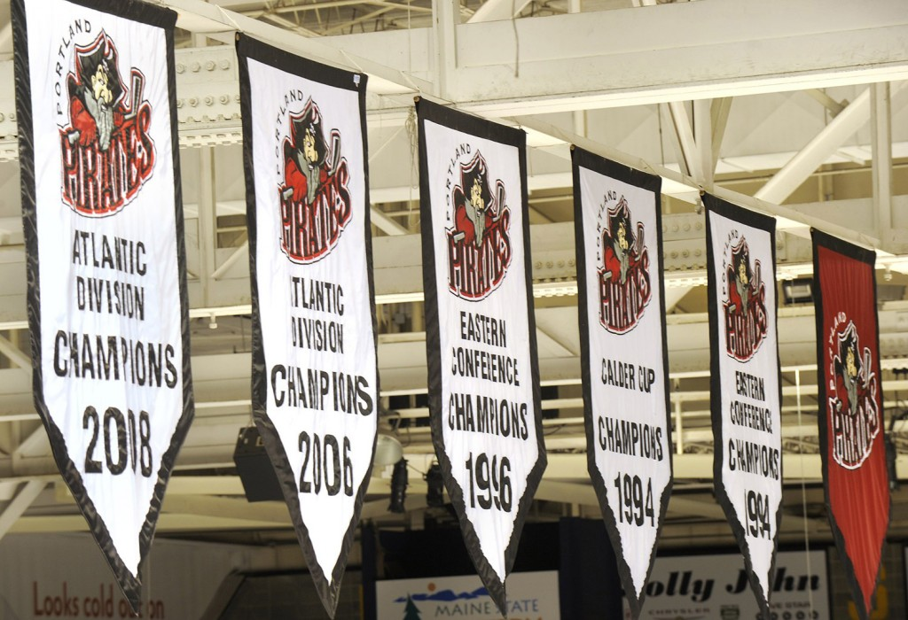The Pirates championship banners hang from the rafters at the Cross Insurance Arena. John Ewing/Staff Photographer